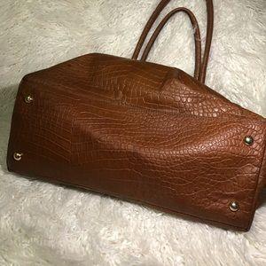Michael Kors Bags - Michael Kors embossed leather carryon